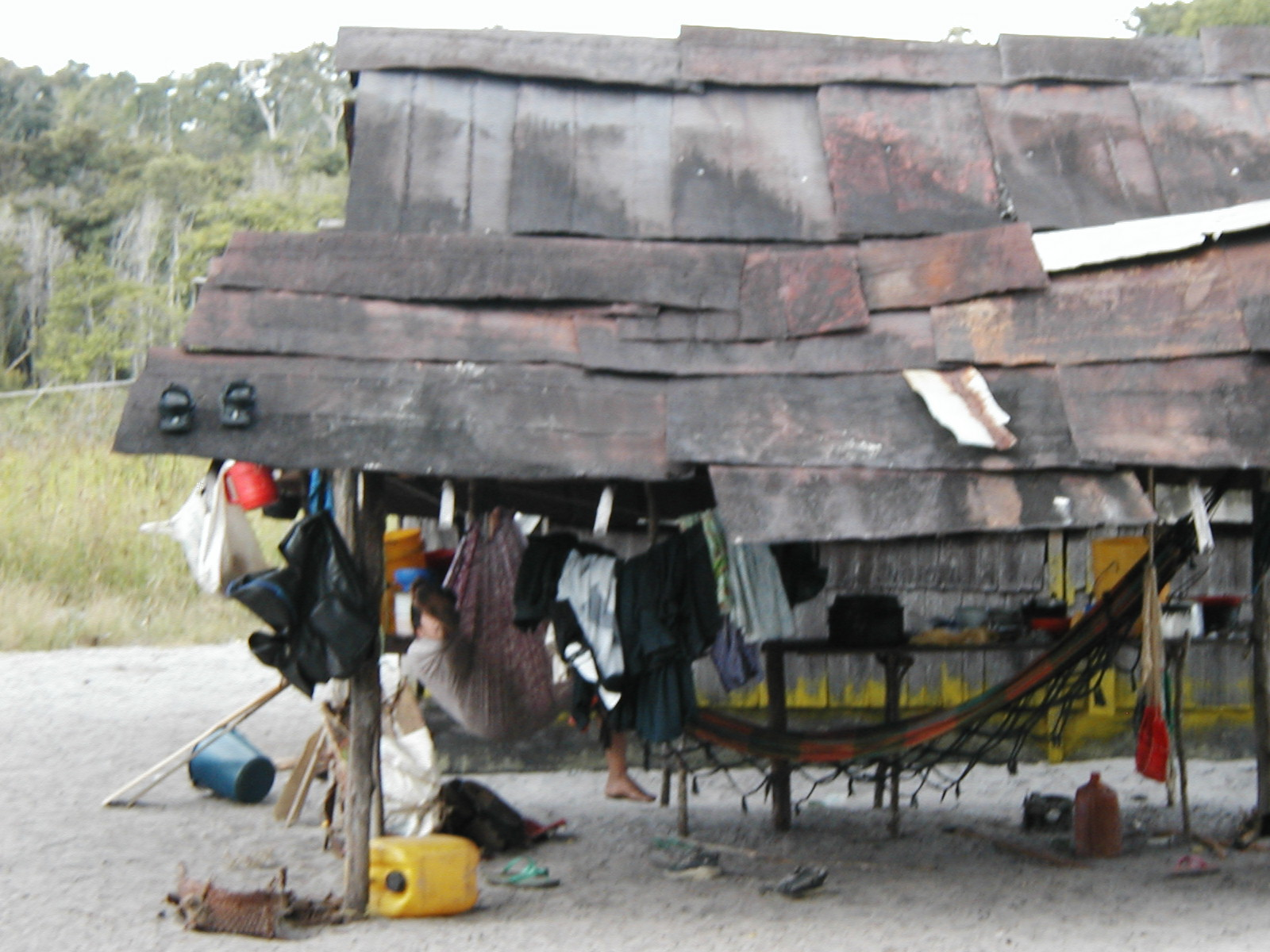 Typical Akawaio house with a roof made of metal drums, flattened out