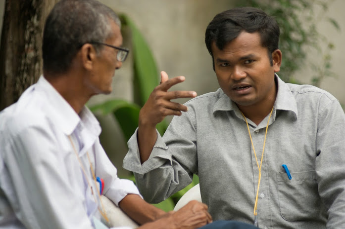 In deep discussion about the future possibilities for Tharu language development