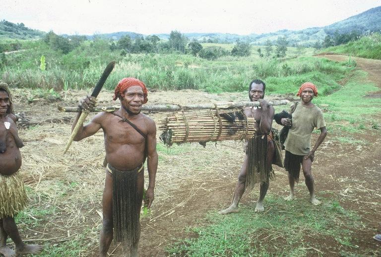 Men Carrying Cassowary